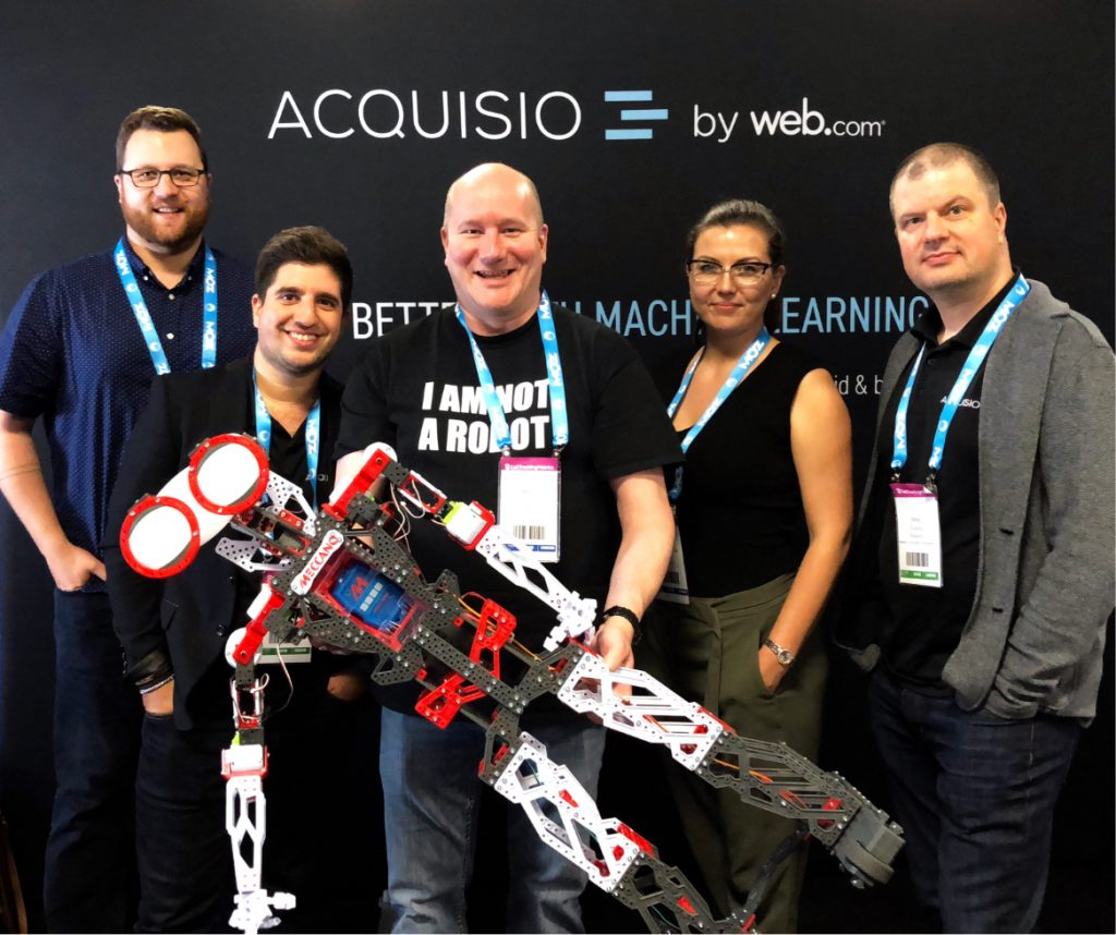 Acquisio team at a trade show: I am not a robot